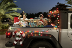 Holiday car parade and caroling